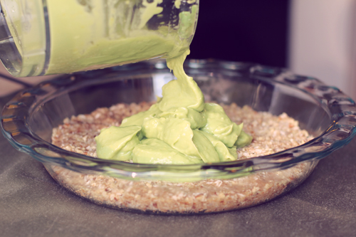 Pouring Avocado and Lemon Filling into Pie Crust