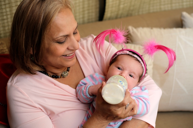 Grandma feeds baby Lillian